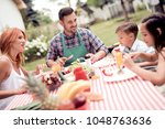 happy young family having...   Shutterstock . vector #1048763636