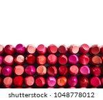 lipsticks isolated on white...   Shutterstock . vector #1048778012