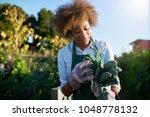 african american female... | Shutterstock . vector #1048778132
