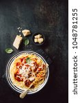 from above plate with pasta... | Shutterstock . vector #1048781255