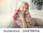 portrait of old woman relaxing... | Shutterstock . vector #1048788446