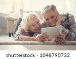 portrait of content pensioners... | Shutterstock . vector #1048790732