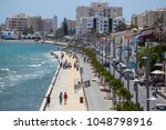 Small photo of 19 of May 2016. Cyprus. Larnaca city, Tourists stroll along the waterfront along the sea. Concept of tourism, beach recreation