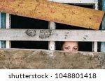 locked up illegal refugee girl... | Shutterstock . vector #1048801418