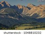 summer eve in alpe di siusi... | Shutterstock . vector #1048810232