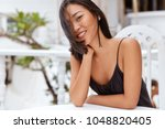 lovely delighted chinese woman... | Shutterstock . vector #1048820405