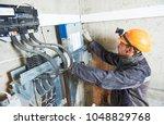 repairing elevator in lift... | Shutterstock . vector #1048829768