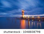 lighthouse at lake neusiedl ... | Shutterstock . vector #1048838798