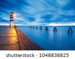 lighthouse at lake neusiedl ... | Shutterstock . vector #1048838825