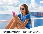 summer vacation woman using... | Shutterstock . vector #1048847828