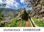 walking alona a levada in... | Shutterstock . vector #1048850108