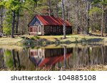 Old Log Cabin Reflection In A...