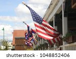 american flag on a house | Shutterstock . vector #1048852406