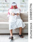Small photo of Arab man addicted to video games
