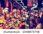 Small photo of BARCELONA, SPAIN - SEPTEMBER 9, 2009: Tourists visit famous La Boqueria market in Barcelona. One of the oldest markets in Europe that still exist.