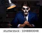 businessman with scary face... | Shutterstock . vector #1048883048