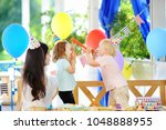 little child and their mother... | Shutterstock . vector #1048888955