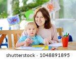 cute little boy drawing and... | Shutterstock . vector #1048891895