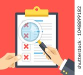 hand holding checklist... | Shutterstock .eps vector #1048899182