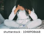 thoughtful worried and sad... | Shutterstock . vector #1048908668