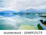 morred boats float lazily on... | Shutterstock . vector #1048915175