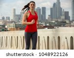 strong determined solo jogger... | Shutterstock . vector #1048922126