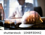 double exposure of engineer... | Shutterstock . vector #1048930442