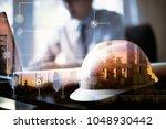 double exposure of engineer... | Shutterstock . vector #1048930442