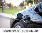 black electric car vehicle... | Shutterstock . vector #1048932785