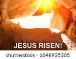 Small photo of The stone is rolled away from the grave on Easter morning. Jesus risen