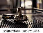 coffee brewer hander place on... | Shutterstock . vector #1048943816