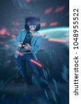 Small photo of Young man with afro hair addicted playing a virtual reality video game. Video game futuristic concept