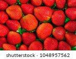 red strawberries background | Shutterstock . vector #1048957562
