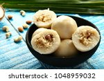 coconut and dry fruits stuffed... | Shutterstock . vector #1048959032