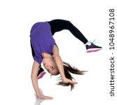 a girl gymnast performs an...   Shutterstock . vector #1048967108