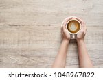 female hand holding a cup of... | Shutterstock . vector #1048967822