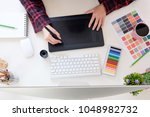 top view a artist workplace... | Shutterstock . vector #1048982732