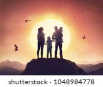 happy family at sunset. father  ... | Shutterstock . vector #1048984778