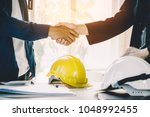 successful deal  male architect ... | Shutterstock . vector #1048992455