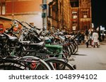 bikes bicycles at amsterdam... | Shutterstock . vector #1048994102