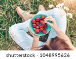 girl in jeans sitting in summer ... | Shutterstock . vector #1048995626