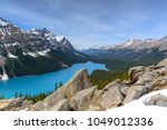 View of Peyto Lake with Snow capped Mountains in Banff National Park, Alberta, Canada