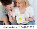 couple enjoying breakfast in bed | Shutterstock . vector #1049021792
