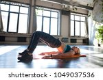sporty girl trains on the mat... | Shutterstock . vector #1049037536