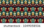 ikat geometric folklore... | Shutterstock .eps vector #1049058536