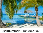 belize cayes   pier on small... | Shutterstock . vector #1049065202