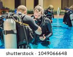 diving instructor and students. ... | Shutterstock . vector #1049066648
