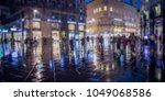 crowd of anonymous people... | Shutterstock . vector #1049068586