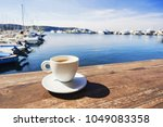 coffee cup on a wood table over ... | Shutterstock . vector #1049083358