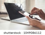 closeup hand touching screen... | Shutterstock . vector #1049086112